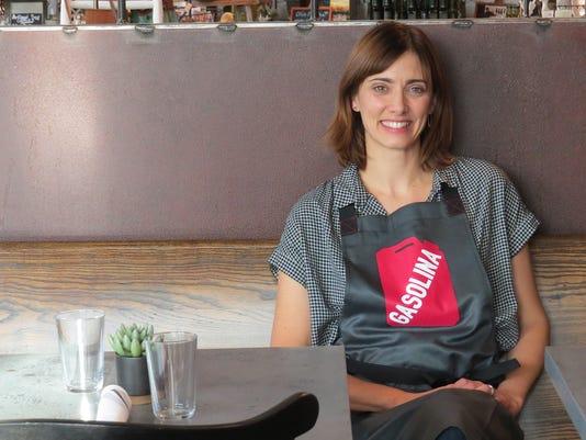 Sandra-Cordero-apron-table-smiling.JPG