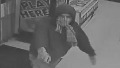 An image taken from security camera footage shows a suspect wanted in an armed robbery at food store in Belleville reported on Wednesday, Dec. 20, 2017.