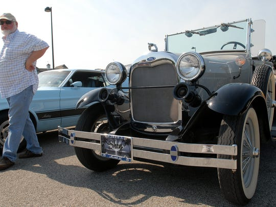 Don Kitchen of Kimball Township walks near his replica of a 1929 Ford Model A in a staging area for the Blue Water Open Cruise along Port Huron's Thomas Edison Parkway.