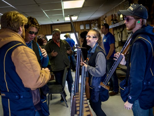 Port Huron Northern student Ashley DeFrain, 17, prepares with her teammates during a Michigan State High School Clay Target League competition Wednesday, April 19, 2017 at the Blue Water Sportsman's Association in Kimball Township.