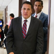 David Barajas (front) walks through the hallway with his lead attorney Sam Cammack at the Brazoria County Courthouse as the jury deliberates on Wednesday, Aug. 27, 2014, in Angleton, Texas.