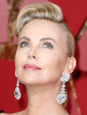 Charlize Theron was dripping in Chopard jewels.The