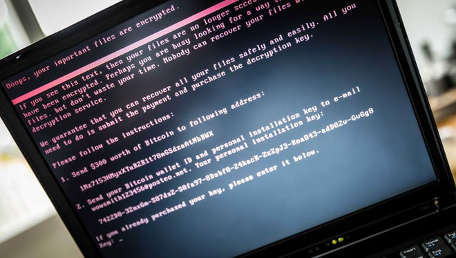 epaselect epa06053537 A laptop screen displays a message after it was infected with ransomware during a worldwide cyberattack, in Geldrop, Netherlands, 27 June 2017 (issued 28 June 2017).  EPA/ROB ENGELAAR ORG XMIT: 52093547