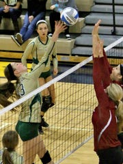 Howell's Ariana Williams puts the ball over the net