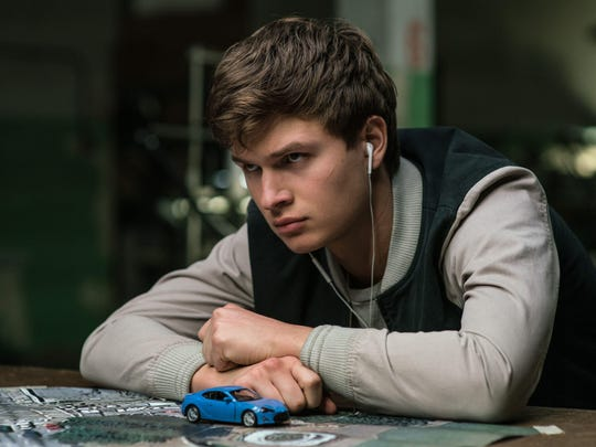 Prodigal wheelman Baby is always listening to his iPod in Baby Driver, in theaters Wednesday.