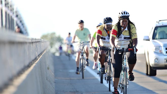 Cassandra Spratling, front right, rides with other cyclists as they train for Wayne State University's Baroodeur, a cycling event to raise money for scholarships, on Belle Isle in Detroit on Wednesday, Aug. 12, 2015.