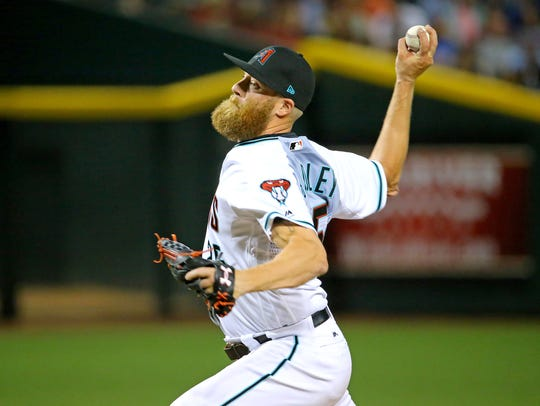 Diamondbacks pitcher Archie Bradley throws against