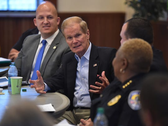 Sen. Bill Nelson (center) is seen April 17, 2017, with