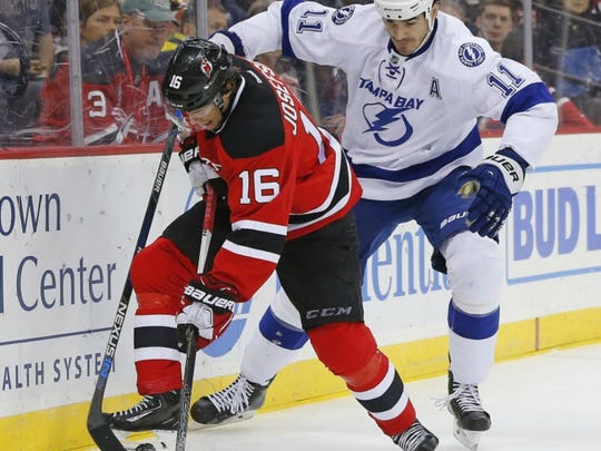 New Jersey center Jacob Josefson (16) fights off Tampa Bay Lightning center Brian Boyle (11) during the first period.