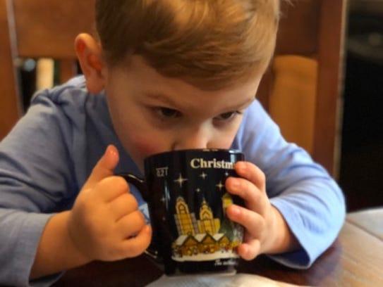 Ben Wesh, 3, drinks hot chocolate at home in Washington