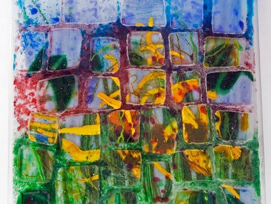 Cheryl Sattler pieces glass together in Summer Quilt.