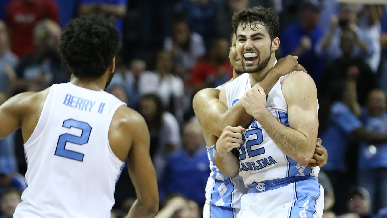 North Carolina celebrate after defeating the Kentucky