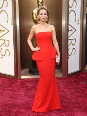Jennifer Lawrence arrives at the 86th annual Academy Awards at the Dolby Theatre.