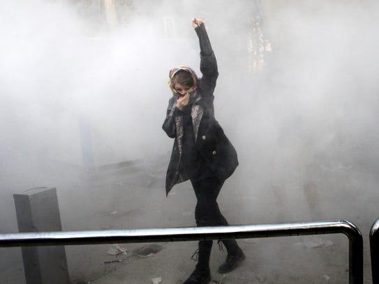 A university student attends a protest inside Tehran