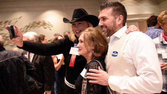 Rebecca Burke, Sharon Strange and Ryan Crosslin pose for a selfie at the Williamson County Republican Party annual Reagan Day Dinner Friday, Feb. 23, 2018 in Franklin, Tenn.