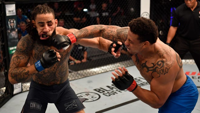 Former NFL defensive end Greg Hardy (left) will make his UFC debut in January against Allen Crowder.