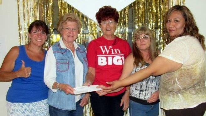 The Deming Loyal Order of Moose 2088 and the Bowinkle Casino present the Deming Animal Guardians with a check for $500.The DAG is a nonprofit organization that provides services to spay and neuter cats and dogs, based on income of pet owners in Deming and Luna County. They also provide a pet food bank. Pictured, from left, are: DAG members Debbie Troyer and Judy Beck and Glenna Dandois,Tiny Johnson and Olivia Morales of the Deming Moose Bowinkle Casino. The money was raised through gaming activities at the lodge.