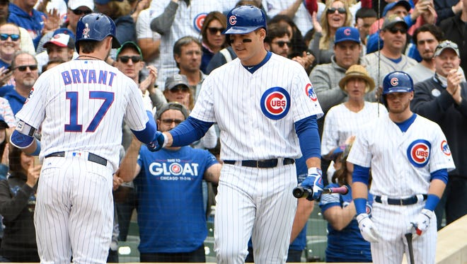 Kris Bryant  is greeted by Anthony Rizzo after hitting a home run against the Milwaukee Brewers at Wrigley Field.