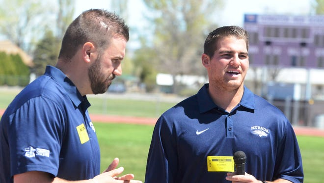 Cody Fajardo, right, the University of Nevada quarterback the past four seasons, visited Yerington High School last month to speak to a lunch time gathering hosted by the YHS Fellowship of Christian Athletes chapter. Accompanying him was FCA Nevada Director James Kitchen, left.
