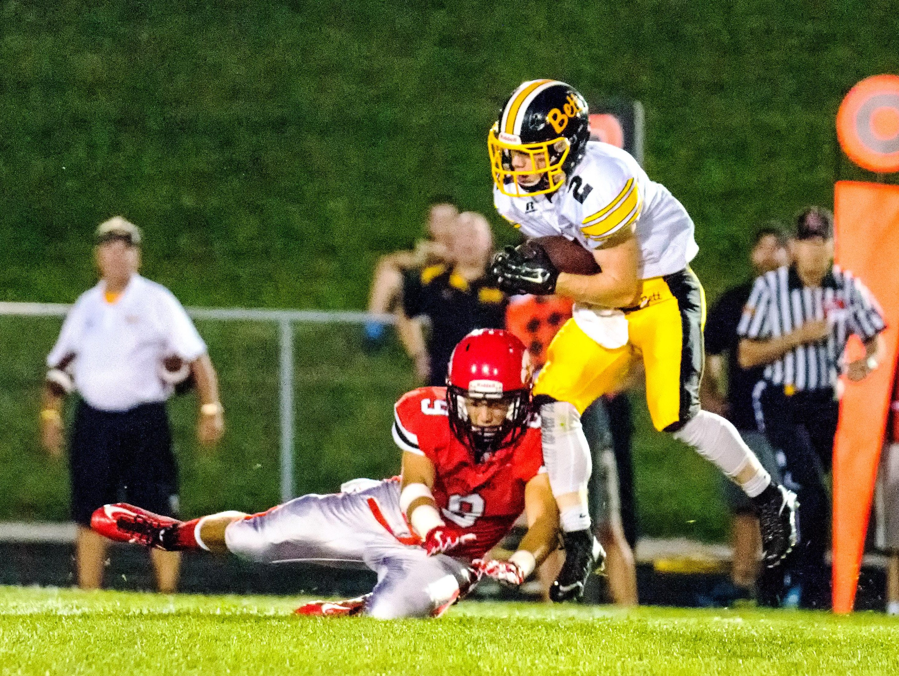 Bettendorf's Matt Wolfe (2) intercepts a pass intended for Griffin Moore (9) at Bates Field in Iowa City on Friday. Bettendorf had three interceptions on the evening and beat the Little Hawks 44-7.