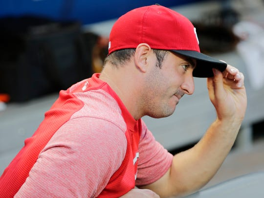 Cincinnati Reds' Matt Harvey gestures to fans after a video tribute to him before a baseball game against the New York Mets Monday, Aug. 6, 2018, in New York.