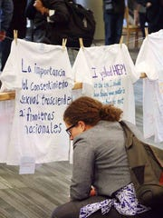 Bridget Copes reads personal sexual assault stories displayed on t-shirts during a demonstration at Vanderbilt University on Nov. 13, 2013 in Nashville, Tenn.
