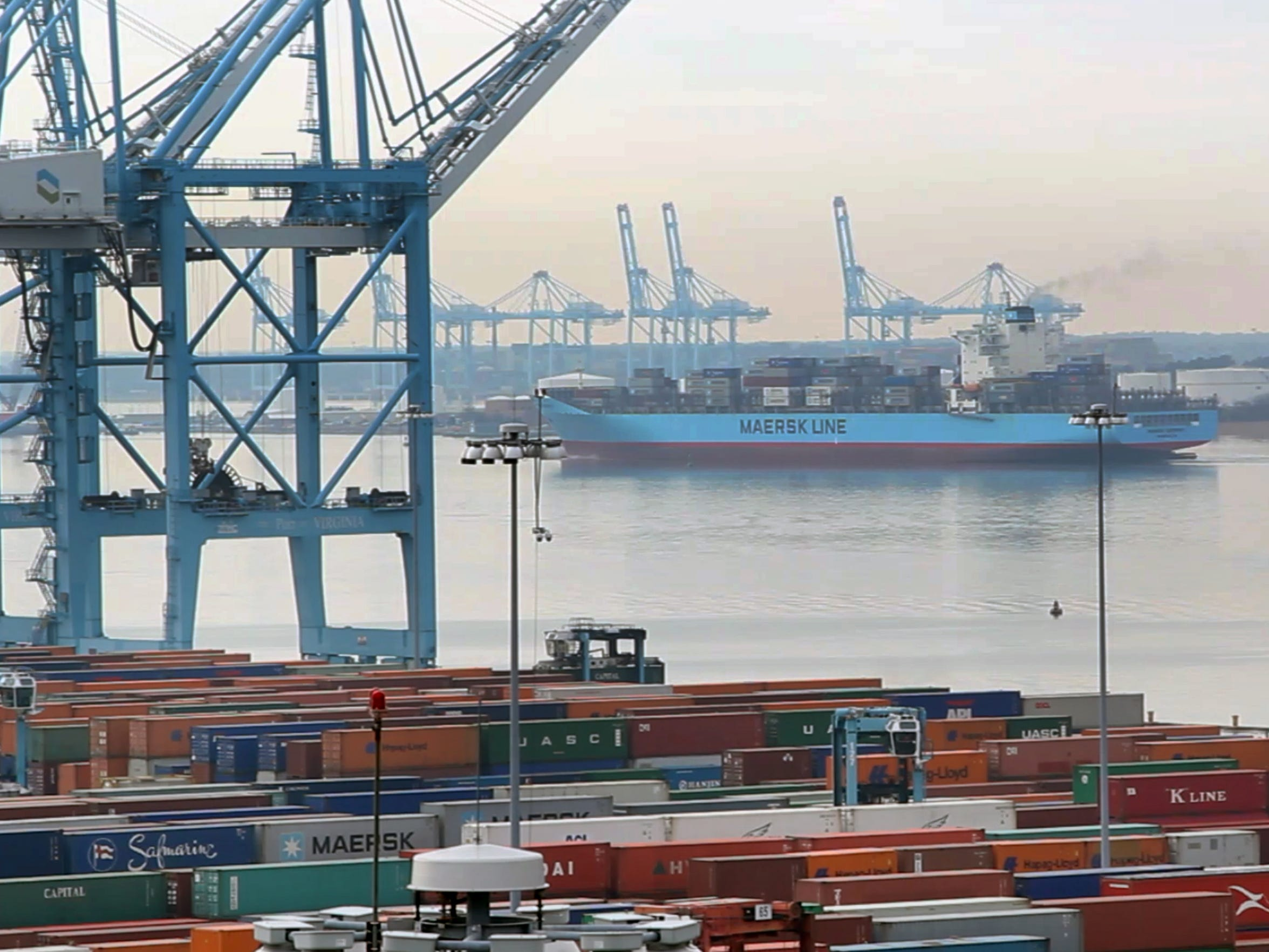 A Maersk Line ship leaves port in Norfolk, Va.