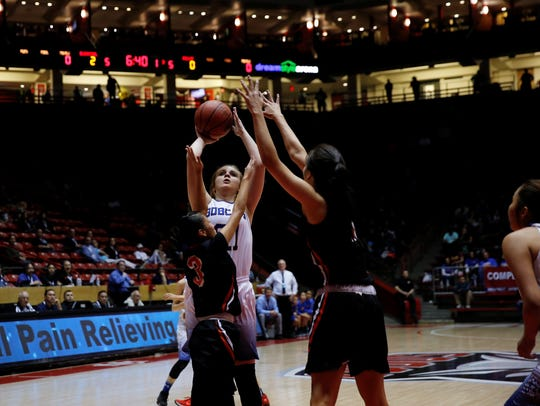 Bloomfield's Halle Payne puts up a shot against Gallup