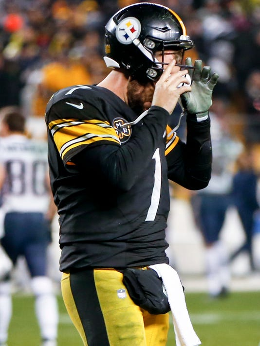 Pittsburgh Steelers quarterback Ben Roethlisberger (7) takes his helmet off as he leaves the field after throwing an interception in the end zone to New England Patriots strong safety Duron Harmon as time runs out in an NFL football game , Sunday, Dec. 17, 2017, in Pittsburgh. (AP Photo/Keith Srakocic)