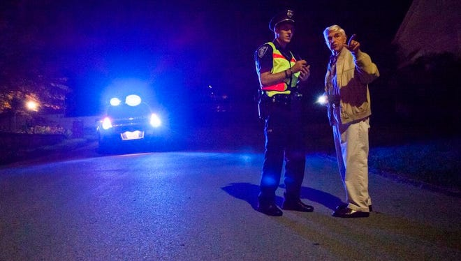 Staunton police officer Corey Wood talks with a nearby resident at the scene of a reported shooting in the 800 block of Cherry Hill Drive on Wednesday, Sept. 30, 2015.