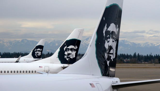 This file photo from Feb. 13, 2009, shows Alaska Airlines planes at Seattle-Tacoma International Airport.