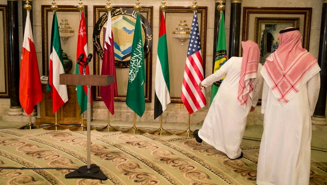 Flags are positioned before President Barack Obama speaks to the media at the Diriyah Palace during the Gulf Cooperation Council Summit in Riyadh, Saudi Arabia, Thursday, April 21, 2016.