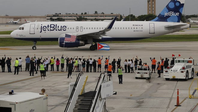 Workers and officials watch as JetBlue Flight 387 prepares for takeoff as it becomes the first scheduled commercial flight to Cuba since 1961 on Wednesday in Fort Lauderdale, Fla. JetBlue hopes to have as many as 110 daily flights under new rules allowing Americans greater access to Cuba.