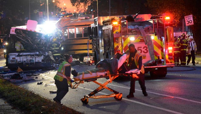 Fire department and rescue officials are at the scene of an early morning fatal collision between a school bus and a commuter bus on Nov. 1, 2016, in Baltimore.