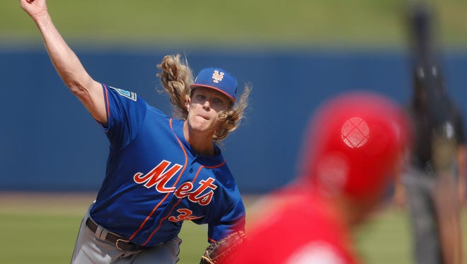 New York Mets starting pitcher Noah Syndergaard (34) delivers a pitch to Washington Nationals' Anthony Rendon in the third inning of a spring training baseball game Thursday, March 8, 2018, in West Palm Beach, Fla.
