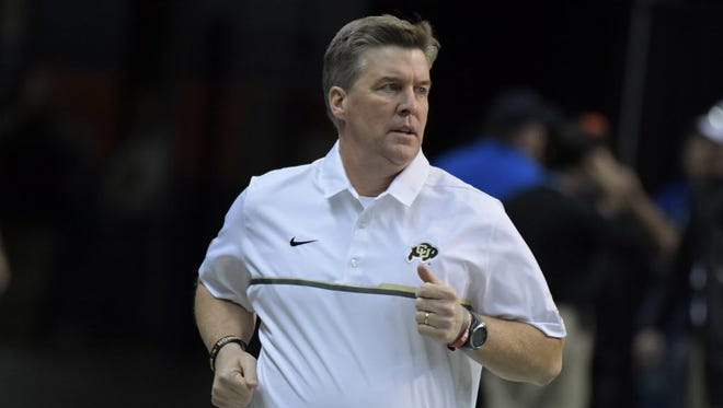 Approval of Colorado head coach Mike MacIntyre's extension has been delayed as the school looks into his handling of domestic abuse allegations levied against a former assistant.