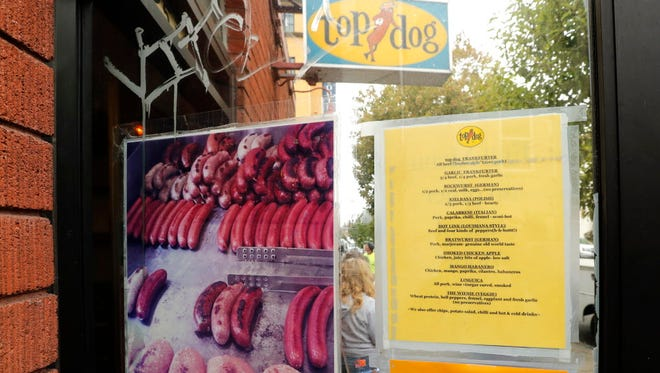 A posted note below the menu on the doorway at Top Dog, a popular fast food chain just off the University of California Berkeley campus  notified customers that an employee, Cole White, who appeared in pictures at a white nationalist protest in Charlottesville, Virginia no longer works at their place of business.