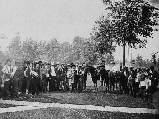 Detroit Mayor Hazen Pingree (mounted), joined by a crowd of Detroiters and his daughter Hazel, appears at the dedication of Grand Boulevard on Aug. 10, 1891.