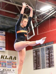 Northville's Rachel Robitaille performs on the balance