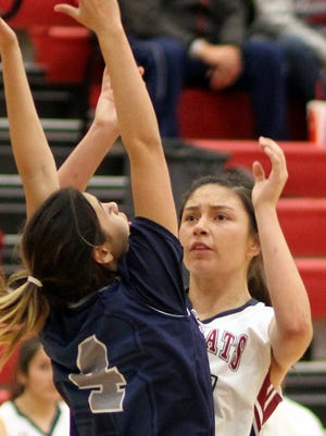 Junior post Adriana Giron (right) had a personal best in in varsity uniform, leading Lady Cat scorere with a career-high 15 points. Giron also collected 7 rebounds, 4 steals and a blocked shot.