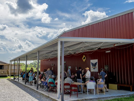 Guests converse during a tour of Bayou Teche Brewing.