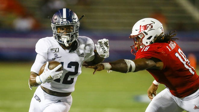 Georgia Southern running back Wesley Kennedy III (12), a Benedictine graduate from Savannah, gets around South Alabama linebacker Kelvin Johnson during a game Oct. 3, 2019, in Mobile, Ala.