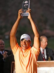 Jhonattan Vegas holds the trophy after winning the