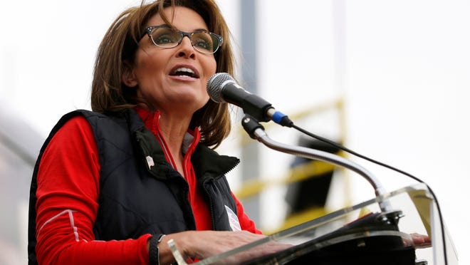 """FILE - This Oct. 12, 2013 file photo shows former Alaska Gov. Sarah Palin during a rally supporting Steve Lonegan who is running for the vacant New Jersey seat in the U.S. Senate, in New Egypt, N.J. The Sportsman Channel said Monday it has hired Sarah Palin to be host of a weekly outdoors-oriented program that will celebrate the """"red, wild and blue"""" lifestyle. The program, """"Amazing America,"""" will debut next April. (AP Photo/Julio Cortez, File) ORG XMIT: NYET101"""