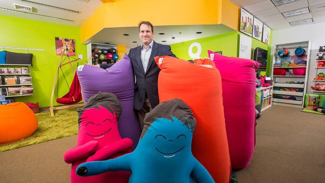 Yogibo CEO Eyal Levy poses with some of the his company's bean bag filled furniture and toys. The company will open its first Delaware store at the Christiana Mall on Feb. 19.