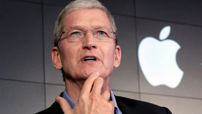 """Apple CEO Tim Cook tells USA TODAY that corporations much have values, """"because people have values, and corporations are just a bunch of people."""" Apple is ramping up its (RED) offerings this year, aiming to funnel more money to the HIV/AIDS organization founded by US singer Bono."""
