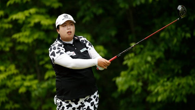 Shanshan Feng watches her drive on the fourth hole during the second round of the LPGA Volvik Championship on Saturday at Travis Pointe Country Club in Ann Arbor, Mich.