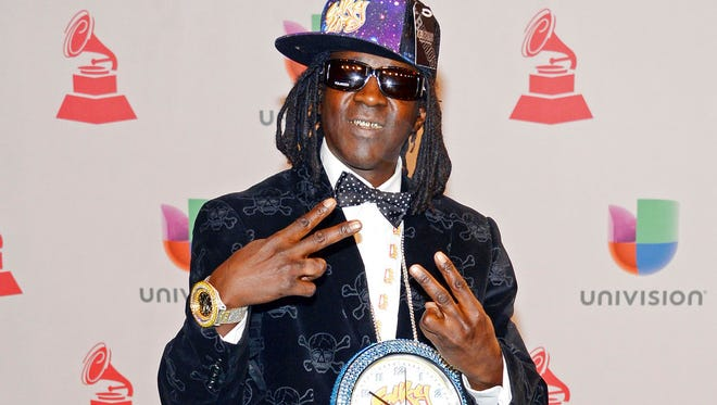 This Nov. 20, 2014 file photo shows rapper Flavor Flav, whose real name is William Jonathan Drayton Jr., at the 15th annual Latin Grammy Awards in Las Vegas. Police in Las Vegas say Ugandi Howard, 44, is facing a misdemeanor battery charge for attacking the entertainer at a local casino.