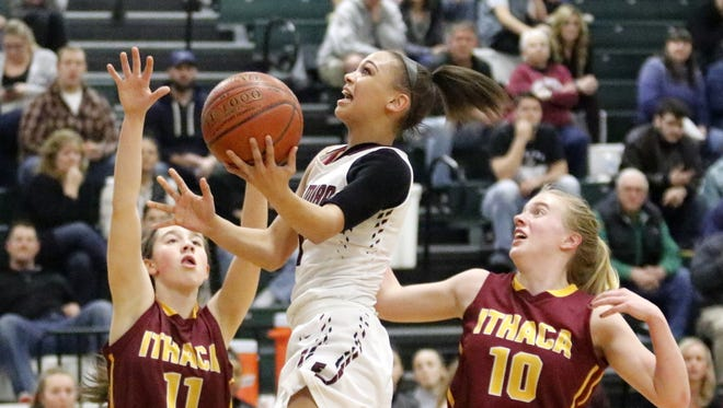 Kiara Fisher of Elmira goes up for a layup in between Ithaca's Georgia Haverlock (11) and Graceann Gorsky on Wednesday in a Section 4 Class AA semifinal at Elmira High School.
