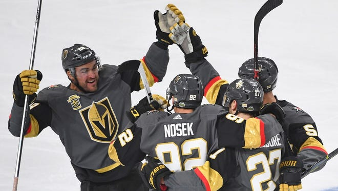 The Vegas Golden Knights celebrate after a goal in the first period against the Los Angeles Kings.